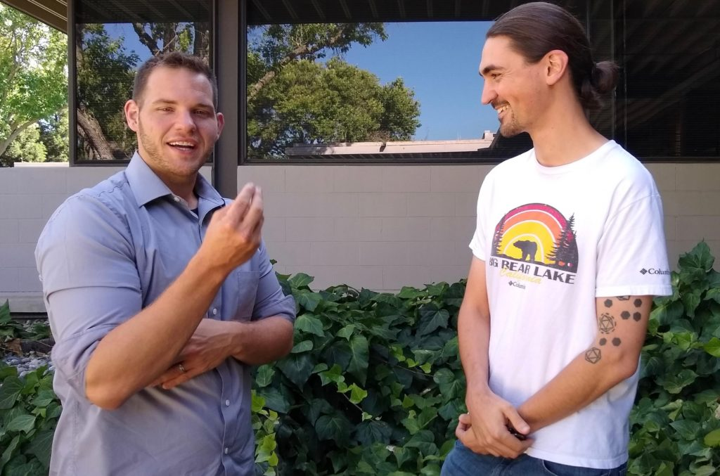 Trubl (left) and Simon Roux (right), research scientist at the JGI, collaborate to uncover viruses in soil. (Photo by Alison F. Takemura)